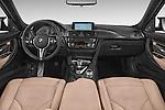 Stock photo of straight dashboard view of a 2018 BMW M3 4 Door Sedan Dashboard