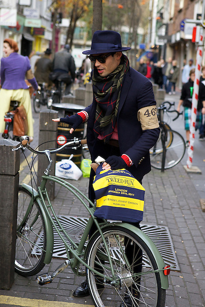 Mark-Francis Vandelli from Made in Chelsea prepares his bicycle for The Tweed Run, London