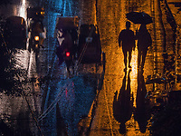 Monsoon season in Manila, dramatic light and a heavy rain shower at night viewed from above made for some abstract images.