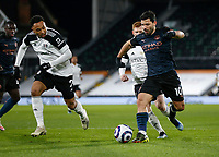13th March 2021, Craven Cottage, London, England;  Manchester Citys Sergio Aguero breaks through against Tete of Fulham during the English Premier League match between Fulham and Manchester City at Craven Cottage in London