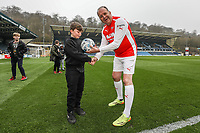 Nev Wilshire presents a signed match ball to the winner of the half time competition during the Celebrity football match in aid of the charity's 'Keep Moving Forward' programme which benefits people with mental health issues put together by Wycombe Wanderers Sports & Education Trust and Sellebrity Soccer Football Match at Adams Park, High Wycombe, England on 7 April 2019. Photo by David Horn.