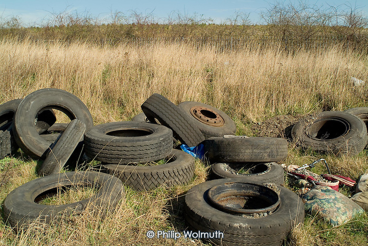 Tyres dumped by the side of the River Lee Navigation in Hackney Wick, close to the proposed site for the 2012 Olympic Games.