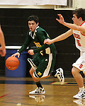 James Sandoval, with Manogue, drives past a Douglas defender during a boys basketball game between Bishop Manogue and Douglas High in Minden, Nev., on Thursday, Dec. 22, 2011..Photo by Cathleen Allison