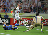 Italian defender (5) Fabio Cannavaro tackles the ball away from  French forward (12) Thierry Henry.  Italy defeated France on penalty kicks after leaving the score tied, 1-1, in regulation time in the FIFA World Cup final match at Olympic Stadium in Berlin, Germany, July 9, 2006.