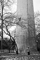 Shows an individual looking up at a huge tower; a metaphor for some of the problems that confront us in daily life.