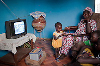 "Afrika Westafrika Mali , Familie schaut Fernsehen mit Solarstrom geladener Autobatterie im Dorf Tiele , Projekt Elcom durch BMZ finaziert und GTZ implementiert  -  Energie Solar  | .Africa Mali , family watch TV with solar-powered TV set with car battery - energy  .| [ copyright (c) Joerg Boethling / agenda , Veroeffentlichung nur gegen Honorar und Belegexemplar an / publication only with royalties and copy to:  agenda PG   Rothestr. 66   Germany D-22765 Hamburg   ph. ++49 40 391 907 14   e-mail: boethling@agenda-fototext.de   www.agenda-fototext.de   Bank: Hamburger Sparkasse  BLZ 200 505 50  Kto. 1281 120 178   IBAN: DE96 2005 0550 1281 1201 78   BIC: ""HASPDEHH"" ,  WEITERE MOTIVE ZU DIESEM THEMA SIND VORHANDEN!! MORE PICTURES ON THIS SUBJECT AVAILABLE!! ] [#0,26,121#]"