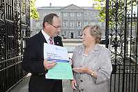 NO REPRO FEE. 7/10/2010. ALZHEIMER SOCIETY PRE-BUDGET SUBMISSION.  Alzheimer Society of Ireland CEO Maurice O'Connell and carer Marjorie Dowling from Dublin who looks after her husband Christopher. They took to the gates of the Dail during the launch of the charity's Pre-Budget Submission to call on the Government to help the tens of thousands of people living with dementia in Ireland and their carers. The Alzheimer Society of Ireland has warned the Government that further funding cuts to its services in the coming Budget will see some of the 44,000 people living with dementia and their 50,000 carers left without even basic support though community services. The charity made its call at the launch of its Pre-Budget Submission 2011 as it revealed that many carers are now at crisis point as figures show waiting lists for dementia services have shot up by 33% in the last year.Picture James Horan/Collins Photos