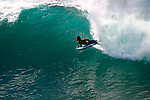 A boogie boarder catches a 6 foot wave.