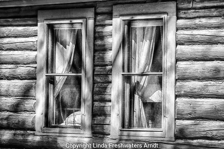 Two log cabin windows