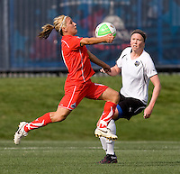Lisa De Vanna of the Washington Freedom takes a first touch on the ball in front of Sarah Larson of the Philadelphia Independence during their preseason game at the Maryland SoccerPlex in Germantown, Maryland.