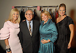 From left: Chair Patti Murphy, designer Max Azira, chair Wendy Burks and chair Rachel Regan backstage at the Saks Fifth Avenue Fashion Show and Luncheon at the Nutcracker Market Thursday Nov. 12,2009. (Dave Rossman/For the Chronicle)