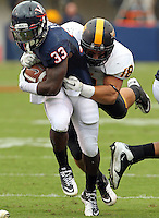 Virginia Cavaliers running back Perry Jones (33) is tackled by Southern Miss Golden Eagles defensive back Daronne Prince (18) during the game at Scott Stadium. Virginia was defeated 30-24. (Photo/Andrew Shurtleff)