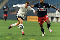 FOXBOROUGH, UNITED STATES - MAY 28: Mitchell Curry #9 of Fort Lauderdale CF on the attack as Francois Dulysse #60 of New England Revolution II defends during a game between Fort Lauderdale CF and New England Revolution II at Gillette Stadium on May 28, 2021 in Foxborough, Massachusetts.
