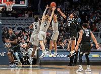 WASHINGTON, DC - FEBRUARY 19: Timothy Ighoefe #5 , Mac McClung #2 and Jahvon Blair #0 of Georgetown go up to block a layup by A.J. Reeves #10 of Providence during a game between Providence and Georgetown at Capital One Arena on February 19, 2020 in Washington, DC.