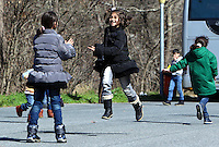 Pictured: Young children play on the motorway Thursday 25 February 2016<br /> Re: Hundreds of migrants, including families with young children, that were stranded at Tempe in central Greece, were forced to walk on foot on the motorway to reach Idomen, about 168 kilometres away, in the northern part of the country, at the Greek FYRO Macedonian border. Local police were at first escorting them, then made sure that they were safely transported on coaches.