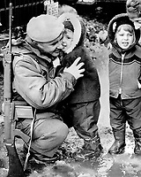 Les soldats de 22ieme regiment quittent Quebec pour Chypre, 1964<br /> <br /> Lance-Cpl; Andre Paquet; 29; among the first members of the Royal 22nd Regiment to leave Quebec City for Cyprus yesterday; gets a farewell kiss from his daughter; Dominique; 3. He is wearing the blue beret fo the UN force being sent to the troubled Mediterranean island to help preserve the peace.<br /> <br /> 1964<br /> <br /> PHOTO :  Frank Grant - Toronto Star Archives - AQP