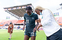 HOUSTON, TX - JUNE 13: Ifeoma Onumonu #13 of Nigeria listens to her assistant coach before a game between Nigeria and Portugal at BBVA Stadium on June 13, 2021 in Houston, Texas.