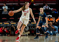 COLLEGE PARK, MD - NOVEMBER 20: Taylor Mikesell #11 of Maryland moves away from Tori Hyduke #11 of George Washington during a game between George Washington University and University of Maryland at Xfinity Center on November 20, 2019 in College Park, Maryland.