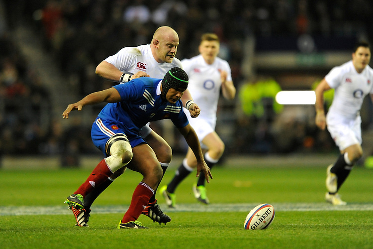 Dan Cole of England harasses Thierry Dusautoir of France during the RBS 6 Nations match between England and France at Twickenham on Saturday 23rd February 2013 (Photo by Rob Munro)