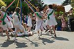 Children dancing around a May Pole Petersham village fete Richmond Surrey UK. Multi ethnic Britain. 2010s 2011 UK