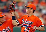 17 February 2006:  Tyler Colvin high-fives a teammate after an inning-ending play in the opening series between James Madison University and Clemson University at Doug Kingsmore Stadium, Clemson, S.C. Photo by Tom Priddy
