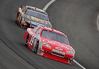 Feb 22, 2009; Fontana, CA, USA; NASCAR Sprint Cup Series driver Tony Stewart leads David Ragan during the Auto Club 500 at Auto Club Speedway. Mandatory Credit: Mark J. Rebilas-