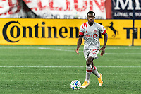 FOXBOROUGH, MA - OCTOBER 7: Richie Laryea #22 of Toronto FC looks to pass during a game between Toronto FC and New England Revolution at Gillette Stadium on October 7, 2020 in Foxborough, Massachusetts.