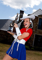 Apr 22, 2014; Kilgore, TX, USA; A member of the Kilgore College Rangerettes poses for a photo with a Wally trophy won by NHRA top fuel dragster driver Steve Torrence at the Torrence estate. Mandatory Credit: Mark J. Rebilas-USA TODAY Sports
