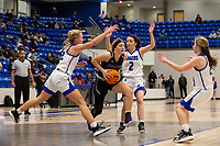 Caroline Lyles (23) of Fayetteville drives through Kate Miller (22) and Aubrey Treadwell (2) of Rogers at King Arena, Rogers, AR January 8, 2021 / Special to NWA Democrat-Gazette/ David Beach