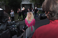 Kelly Page of Dogs Deserve Better speaks to the press after giving a dog locked in a basement water in Shoreline, WA on September 28, 2010.  <br /> <br /> King County Animal Control who has been called to this house on animal cruelty complaints for over seven years, has again been out there a couple of times in the past week but has failed to do anything to help this dog.<br /> It is case # 10-06739. The house is located at :<br /> 14711 23rd Ave. NE., Shoreline, WA 98155.  The house and property are filthy and appears like it should be condemned. (photo © Karen Ducey 2010)