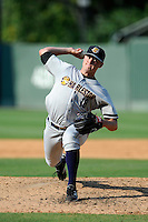 Pitcher Jordan Foley (18) of the Charleston RiverDogs delivers a pitch in a game against the Greenville Drive on Monday, June 29, 2015, at Fluor Field at the West End in Greenville, South Carolina. Greenville won, 4-2. (Tom Priddy/Four Seam Images)