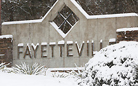 Snow begins to cover Monday, February 15, 2021, the letters of a sign in Fayetteville. The National Weather Service is forecasting several inches of snow throughout the state through Wednesday and Thursday. Check out nwaonline.com/210216Daily/ and nwadg.com/photos for a photo gallery.<br /> (NWA Democrat-Gazette/David Gottschalk)