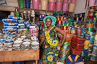Gbongar, Plastic Goods Vendor, Monrovia, Liberia, 2014<br /> Gbongar Kamara received a loan from a microfinance program, run by an NGO called BRAC, which allowed her to start selling plastic goods in the Red Hill market in Monrovia, Liberia. Women here meet in weekly groups to repay their loans, and if one can't pay back her loan that week, the other women will chip in and help her. Gbongar is proud that her business is doing well; she makes about $300 per month.