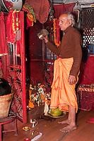 Kathmandu, Nepal.  Hindu Priest in Neighborhood Shrine.