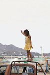 YOUNG GIRL IN SAN FELIPE HARBOR BALANCES ON TRUCK