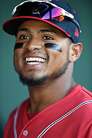 Second baseman Kervin Suarez (36) of the Greenville Drive, playing as the Energia in MiLB's Copa de la Diversion, in the dugout before a game against the Augusta GreenJackets on April 10, 2019, at Fluor Field at the West End in Greenville, South Carolina. Augusta won, 9-8. (Tom Priddy/Four Seam Images)