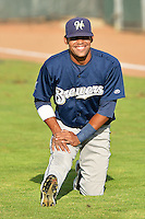 Dionis Hinojosa (27) of the Helena Brewers warms up prior to the game against the Ogden Raptors at Lindquist Field on July 23, 2013 in Ogden Utah. (Stephen Smith/Four Seam Images)