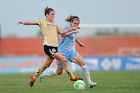 Kelley O'Hara (7) of FC Gold Pride and Heather O'Reilly (9) of Sky Blue FC batle for the ball. FC Gold Pride defeated Sky Blue FC 1-0 during a Women's Professional Soccer (WPS) match at Yurcak Field in Piscataway, NJ, on May 1, 2010.