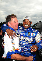 Sept. 18, 2011; Concord, NC, USA: NHRA top fuel dragster driver Antron Brown (right) celebrates with crew chief Mark Oswald after winning the O'Reilly Auto Parts Nationals at zMax Dragway. Mandatory Credit: Mark J. Rebilas-