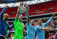 Goalkeeper Ederson of Manchester City and Gabriel Jesus of Manchester City celebrate with the FA Cup during the FA CUP FINAL match between Manchester City and Watford at Wembley Stadium, London, England on 18 May 2019. Photo by Andy Rowland.