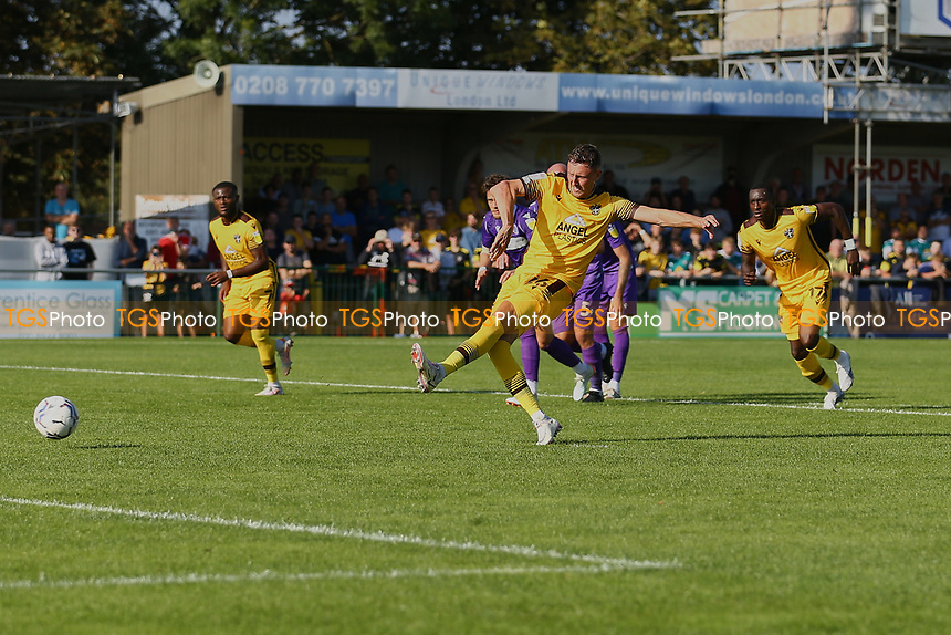 Richie Bennett of Sutton United scores the second goal for his team from the spot and celebrates during Sutton United vs Stevenage, Sky Bet EFL League 2 Football at the VBS Community Stadium on 11th September 2021