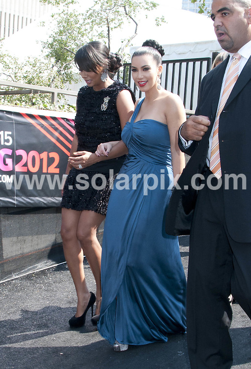 **ALL ROUND PICTURES FROM SOLARPIX.COM**                                             **SYNDICATION RIGHTS FOR UK, AUSTRALIA, DENMARK, PORTUGAL, S. AFRICA, SPAIN & DUBAI (U.A.E) & ASIA (EXCLUDING JAPAN) ONLY**                                                                                  Caption:  Mercedes-Benz Fashion Week Spring 2012  at the Lincoln Center in New York City, NY, USA                                                                             This pic:  La La and Kim Kardashian                                                                                            JOB REF: 13935       PHZ/mayer       DATE: 13.09.2011                                                           **MUST CREDIT SOLARPIX.COM OR DOUBLE FEE WILL BE CHARGED**                                                                      **MUST AGREE FEE BEFORE ONLINE USAGE**                               **CALL US ON: +34 952 811 768 or LOW RATE FROM UK 0844 617 7637**