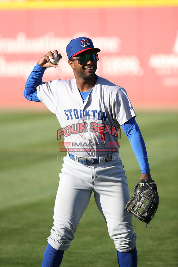Danny Bautista (5) of the Stockton Ports throws before a game against the Rancho Cucamonga Quakes at LoanMart Field on May 26, 2021 in Rancho Cucamonga, California. (Larry Goren/Four Seam Images)