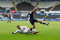 Harry Cornick of Luton Town is tackled by Jake Bidwell of Swansea City during the Sky Bet Championship match between Swansea City and Luton Town at the Liberty Stadium in Swansea, Wales, UK. Saturday 27 June 2020.