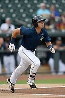 First baseman Jeremy Vasquez (20) of the Columbia Fireflies runs out a batted ball in a game against the Greenville Drive on Saturday, May 26, 2018, at Spirit Communications Park in Columbia, South Carolina. Columbia won, 9-2. (Tom Priddy/Four Seam Images)