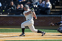 Joey Rodriguez (8) of the Wake Forest Demon Deacons strokes a double down the left field line against the Richmond Spiders at David F. Couch Ballpark on March 6, 2016 in Winston-Salem, North Carolina.  The Demon Deacons defeated the Spiders 17-4.  (Brian Westerholt/Four Seam Images)