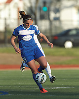 Boston Breakers defender Cat Whitehill (4) controls the ball. In a National Women's Soccer League Elite (NWSL) match, the Boston Breakers (blue) defeated Chicago Red Stars (white), 4-1, at Dilboy Stadium on May 4, 2013.