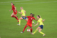 YOKOHAMA, JAPAN - AUGUST 6: Kosovare Asllani #9 of Sweden is marked by Jayde Riviere #8 of Canada during a game between Canada and Sweden at International Stadium Yokohama on August 6, 2021 in Yokohama, Japan.