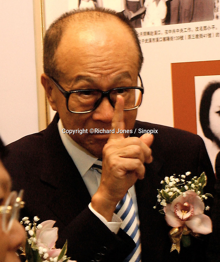 """Li Ka Shing was at the opening ceremony of """"Giant of the Century"""" - an exhibition to commemorate the 100th Anniversary of the Birth of Deng Xiaoping in Hong Kong. The exhibition aims at introducing Deng's life to the people of Hong Kong.<br /> 26-AUG-04"""