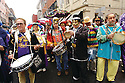 Men play tambourines in French Quarter for Mardi Gras, 2004